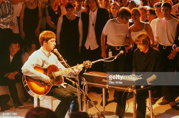 ROOM Photo of OASIS and Noel GALLAGHER and Paul WELLER with Noel Gallagher of Oasis performing on UK TV show playing Wurlitzer electric piano