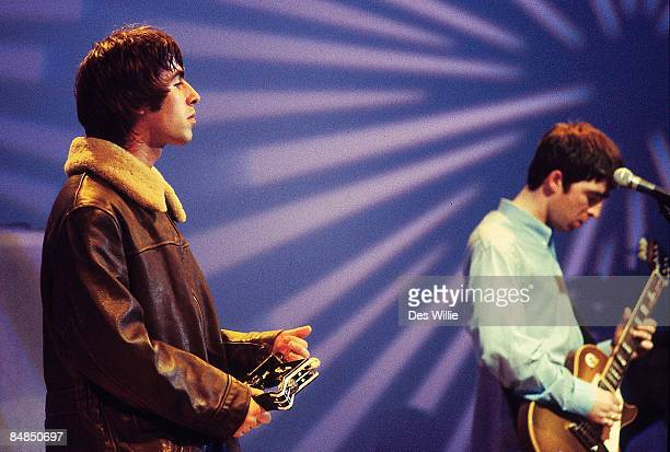 Photo of OASIS; Liam Gallagher and Noel Gallagher performing on UK TV show