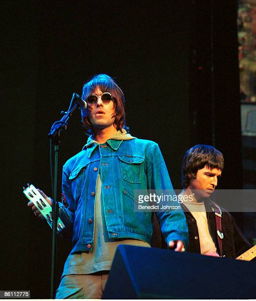 Photo of OASIS, L-R: Liam Gallagher, Noel Gallager - performing live onstage