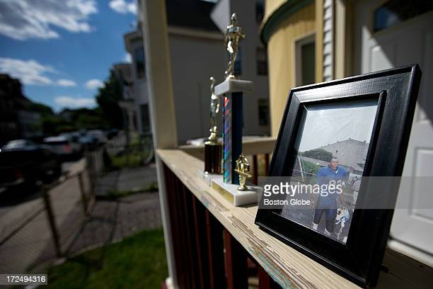 Photo of Odin Lloyd was on the porch next to some trophies. Trophies and a picture of Odin Lloyd were left at 10 Fayston St. Where Lloyd resided in...