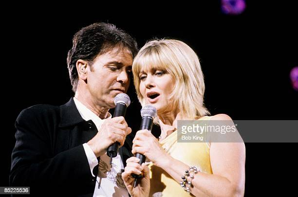 Photo of OLIVIA NEWTONJOHN and Cliff RICHARD LR Cliff Richard Olivia NewtonJohn performing live onstage