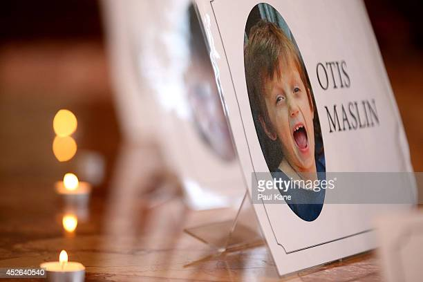 A photo of Otis Maslin is seen on during a memorial service held for victims of the MH17 disaster at St Mary's Cathedral on July 25 2014 in Perth...