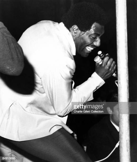 Photo of Otis REDDING Performing on stage with 2 microphones