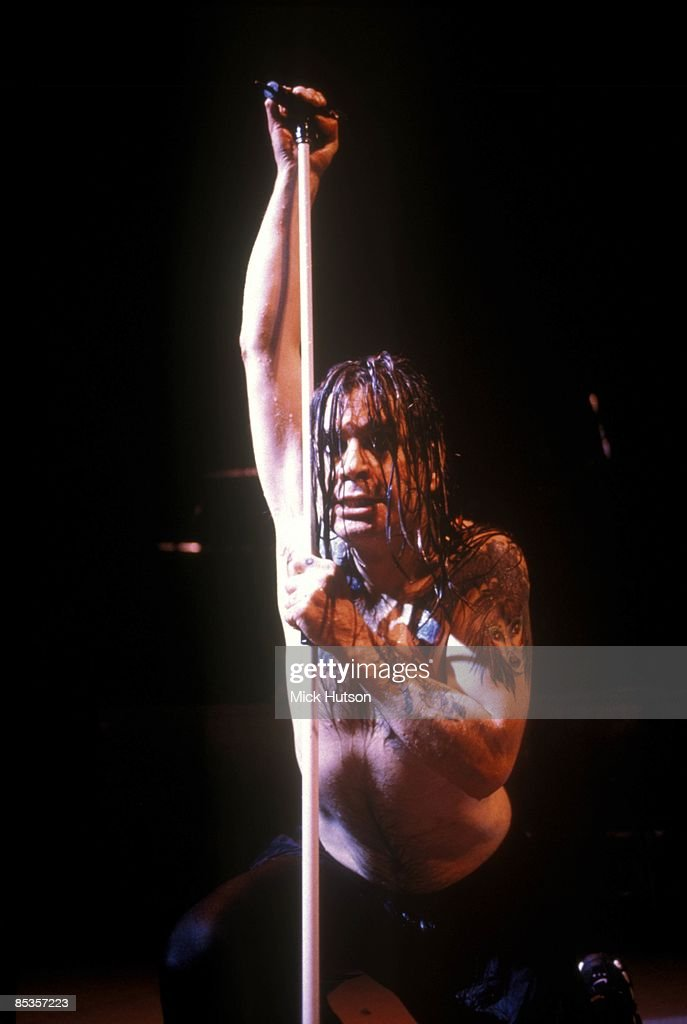 Photo of Ozzy OSBOURNE; Ozzy Osbourne performing on stage, barechested on knees