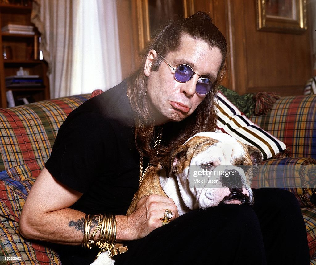 Photo of Ozzy OSBOURNE; posed, at home with his bulldog Baldrick