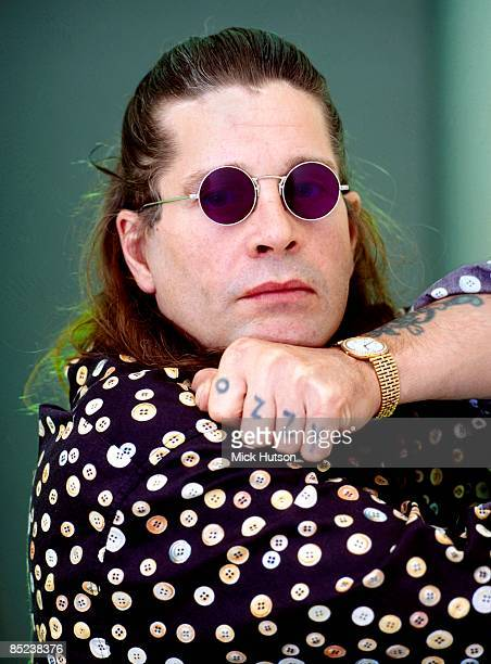 Photo of Ozzy OSBOURNE posed showing 'Ozzy' tattoo on knuckles
