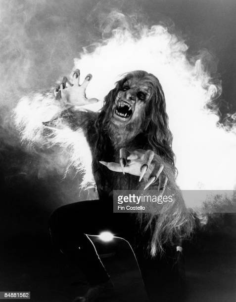 Photo of Ozzy OSBOURNE posed studio made up as werewolf during 'Bark at the Moon' album cover shoot