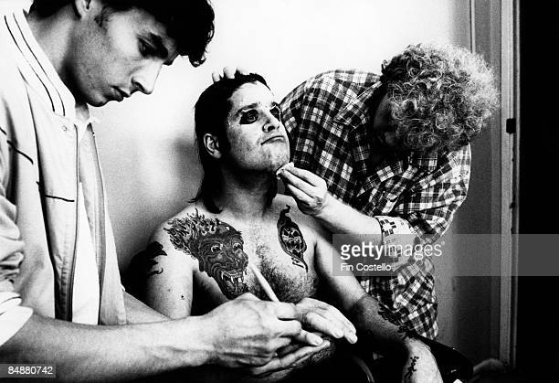 Photo of Ozzy OSBOURNE with Greg Channon makeup artist on 'Nightmare on Elm Street' doing makeup for 'Bark At The Moon' album cover session