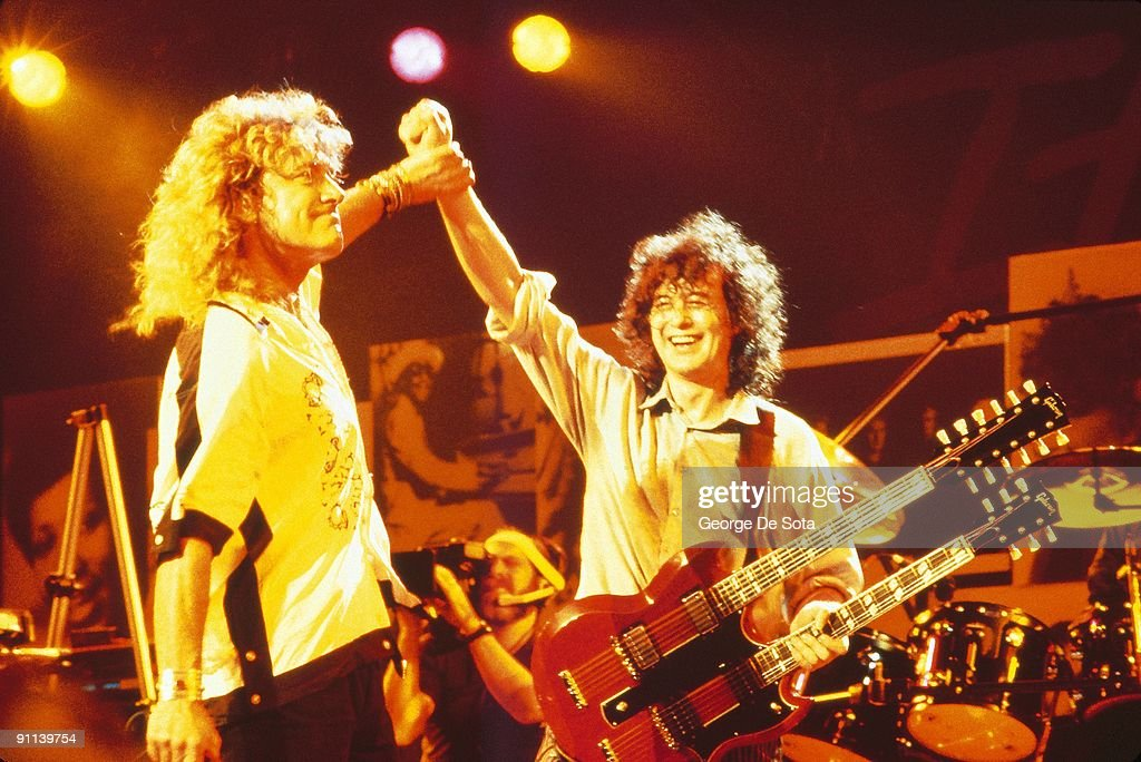 Photo of PAGE & PLANT and Jimmy PAGE and Robert PLANT and LED ZEPPELIN; L-R: Robert Plant, Jimmy Page performing together at the 'Atlantic Records 40th Anniversary Show' in Madison Square Gardens, New York (Photo by George De Sota (ID 5073478)/Redferns)