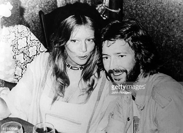 Photo of Patti BOYD and Eric CLAPTON, Patti Boyd & Eric Clapton posed at a party at the Cherokee Studios