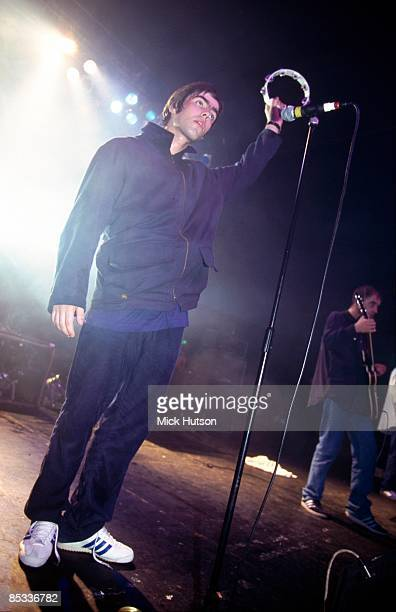 Photo of Paul Bonehead ARTHURS and Liam GALLAGHER and OASIS, Liam Gallagher and Paul 'Bonehead' Arthurs performing on stage, tambourine