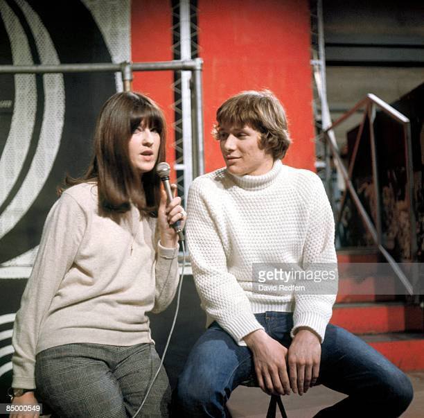 Photo of Paul JONES and Cathy McGOWAN, with Paul Jones of Manfred Mann presenting Ready Steady Go! On set at Wembley Studios