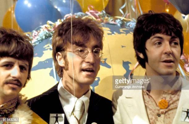STUDIOS Photo of Paul McCARTNEY and BEATLES and Ringo STARR and John LENNON LR Ringo Starr John Lennon Paul McCartney posed at press call for Our...