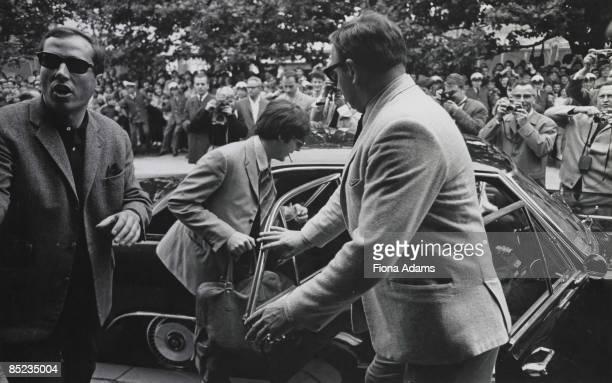 Photo of Paul McCARTNEY and BEATLES Paul McCartney getting into car on final German tour