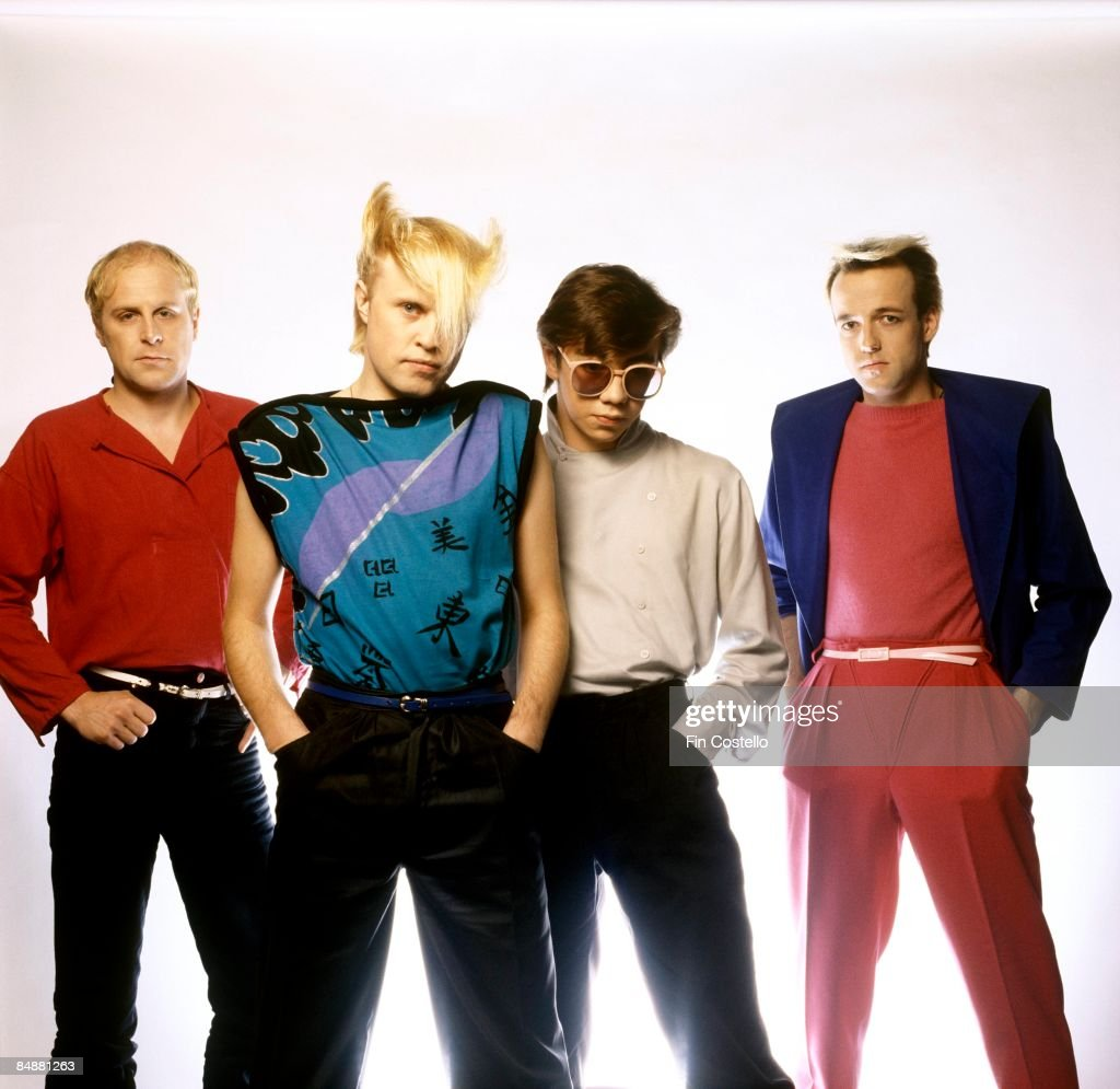 Photo of Paul REYNOLDS and Ali SCORE and Frank MAUDSLEY and FLOCK OF SEAGULLS and Mike SCORE; L-R: Ali Score, Mike Score, Paul Reynolds, Frank Maudsley - posed, group shot, studio