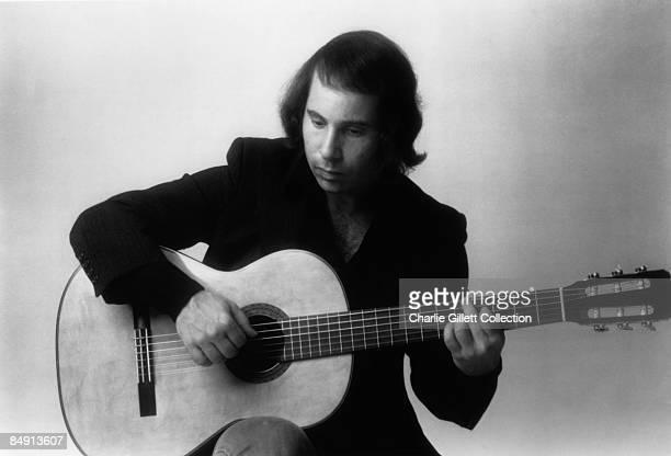 Photo of Paul SIMON Posed with guitar