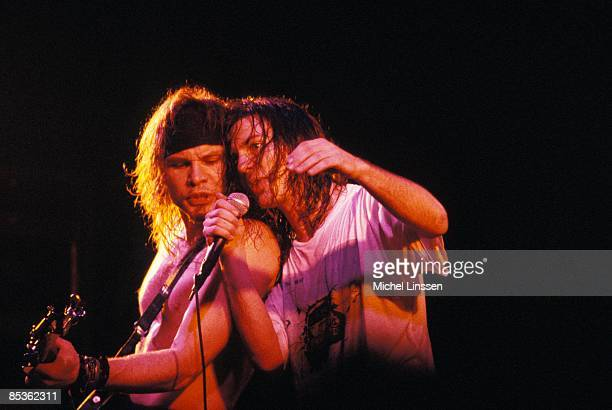 Photo of PEARL JAM and Eddie VEDDER and Jeff AMENT Jeff Ament and Eddie Vedder performing live onstage