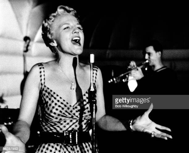 Photo of Pete CANDOLI and Peggy LEE, live in Lake Tahoe.Peter Candoli on trumpet in background