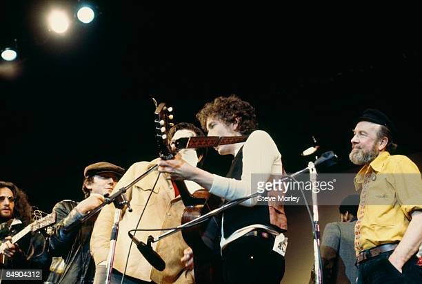 Photo of Pete SEEGER and Bob DYLAN; Bob Dylan and Pete Seeger performing on stage at the Friends Of Chile Benefit at the Felt Forum