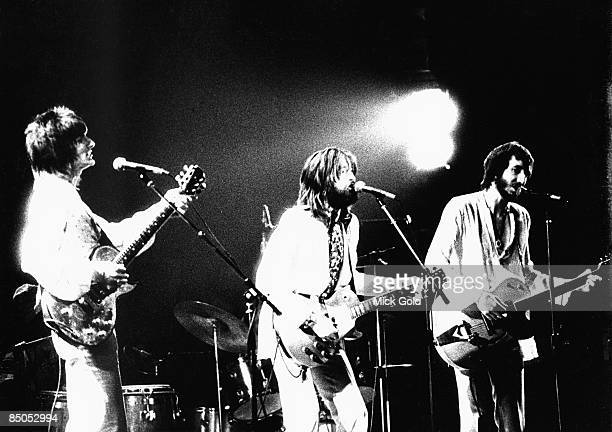 Photo of Pete TOWNSHEND and Ronnie WOOD and Ron WOOD and Eric CLAPTON, Ron Wood & Pete Townshend on stage with Eric Clapton performing live onstage...