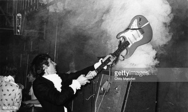 HALLS Photo of Pete TOWNSHEND and The Who Pete Townshend performing live onstage smashing guitar against amplifier