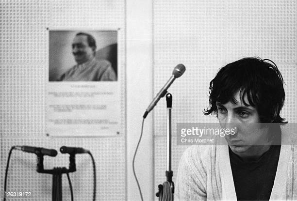 Photo of Pete TOWNSHEND and WHO, Pete Townshend, guitarist with The Who posed in home studio in 1969. Behind him hangs a portrait of spiritual guru...