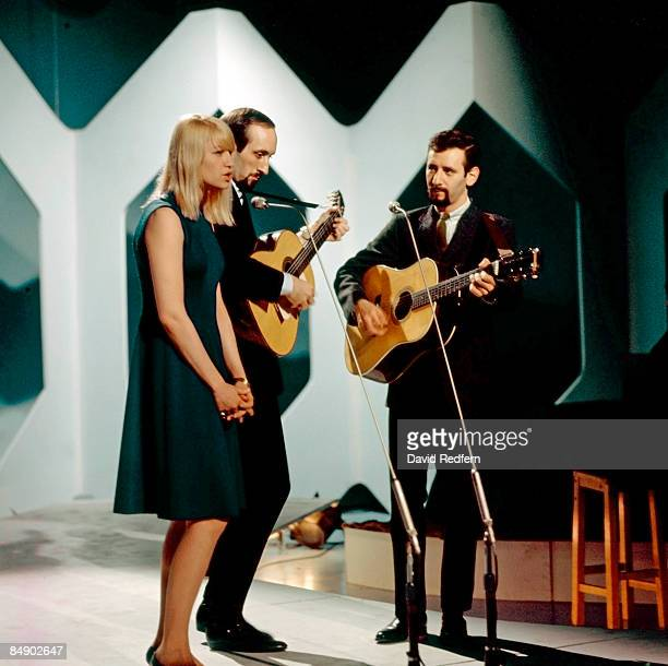 Photo of PETER PAUL MARY Group performing on stage LR Mary Travers Noel Paul Stookey and Peter Yarrow