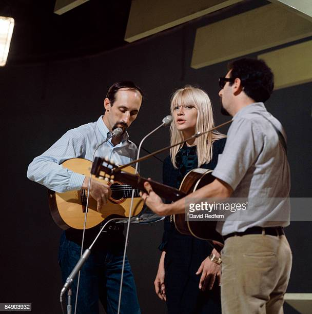Photo of PETER PAUL MARY Group performing on stage LR Noel Paul Stookey Mary Travers and Peter Yarrow