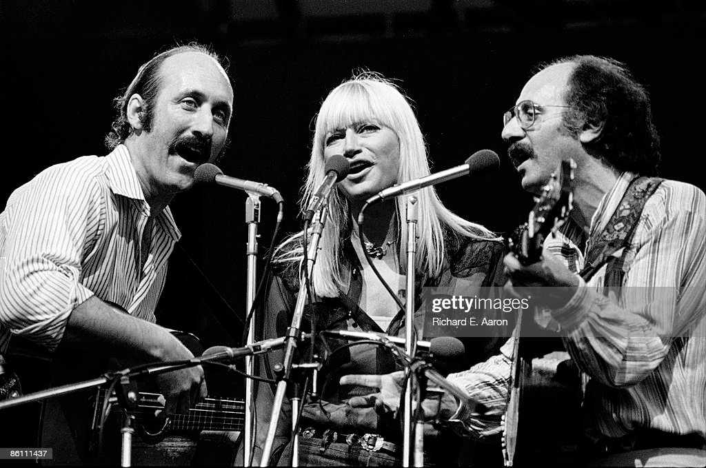 Photo of PETER, PAUL & MARY; Group performing on stage - Noel 'Paul' Stookey, Mary Travers and Peter Yarrow