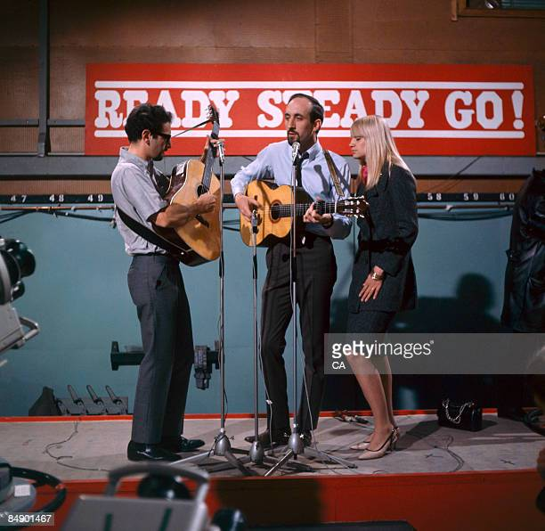 Photo of PETER PAUL MARY Group performing on tv show LR Peter Yarrow Noel Paul Stookey and Mary Travers