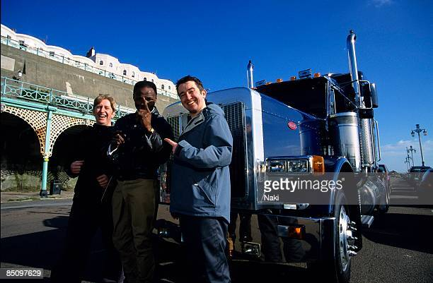 Photo of PHATS AND SMALL and Jason HAYWARD and Russell SMALL LR Russell Smalll Chris Eubank and Jason Hayward in front of a truck during a video shoot