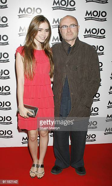 BREWERY Photo of Phil COLLINS and Lily COLLINS posed with daughter Lily arriving at awards