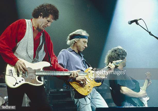 Photo of Phil PALMER and John ILLSLEY and DIRE STRAITS and Mark KNOPFLER LR John Illsley Mark Knopfler Phil Palmer performing live onstage