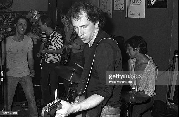Photo of Pick WITHERS and DIRE STRAITS and Mark KNOPFLER Mark Knopfler Pick Withers drums performing live onstage in pub