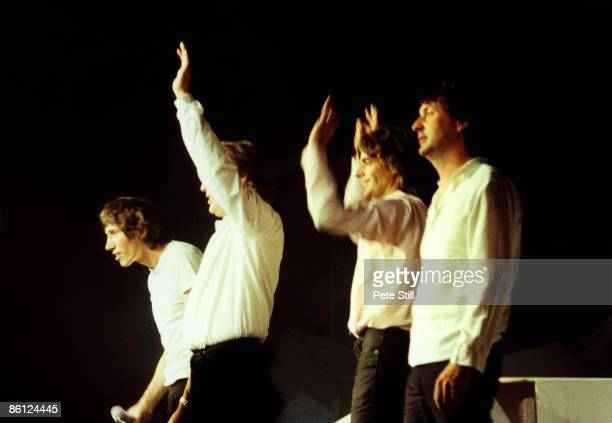 Roger Waters Dave Gilmour Rick Wright Nick Mason waving to crowd group shot onstage atThe Wall concert