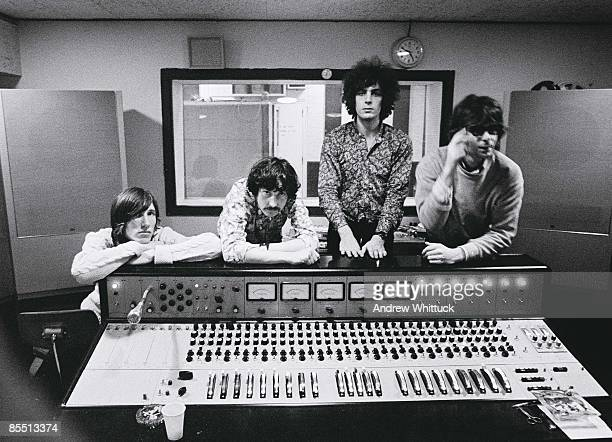 Photo of PINK FLOYD LR Roger Waters Nick Mason Syd Barrett Rick Wright posed group shot at mixing desk in recording studio control room