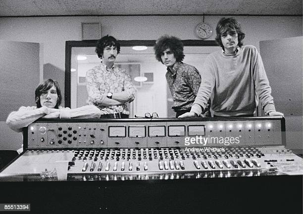 Photo of PINK FLOYD LR Roger Waters Nick Mason Syd Barrett Rick Wright posed group shot standing behind mixing desk in recording studio control room