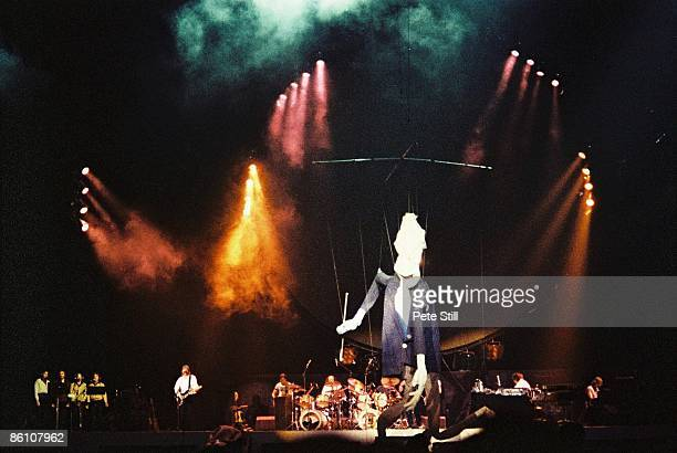 Photo of PINK FLOYD performing live onstage with giant puppet The Wall Concert