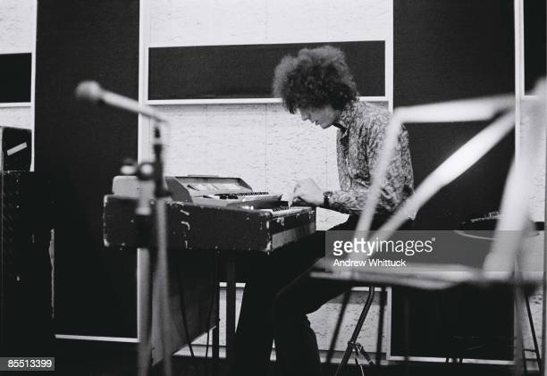 Photo of PINK FLOYD Syd Barrett playing keyboards in the recording studio