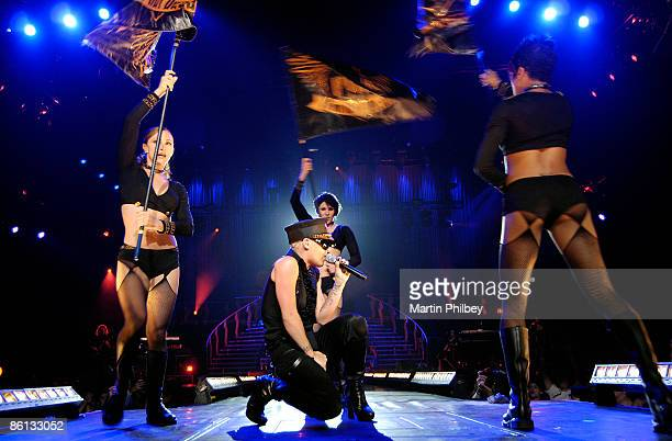 Photo of PINK Performing live on stage with backing dancers