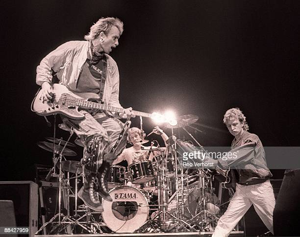 AHOY Photo of POLICE and Stewart COPELAND and STING and Andy SUMMERS LR Sting Stewart Copeland Andy Summers performing live onstage