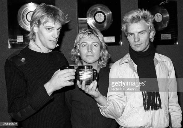 Photo of POLICE LR Stewart Copeland Andy Summers and Sting at the AM offices after signing their record deal