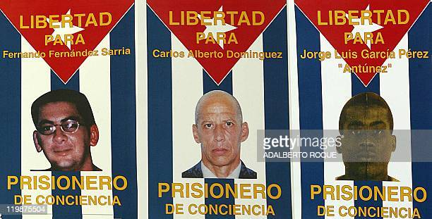 Photo of posters with Cuban dissidents who have been encarcerated by the Cuban government 03 January 2002 in La Habana Cuba Imagen compuesta de tres...