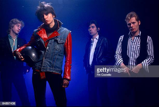 Photo of PRETENDERS and James HONEYMAN SCOTT and Chrissie HYNDE and Pete FARNDON and Martin CHAMBERS; Posed studio group portrait L-R James Honeyman...