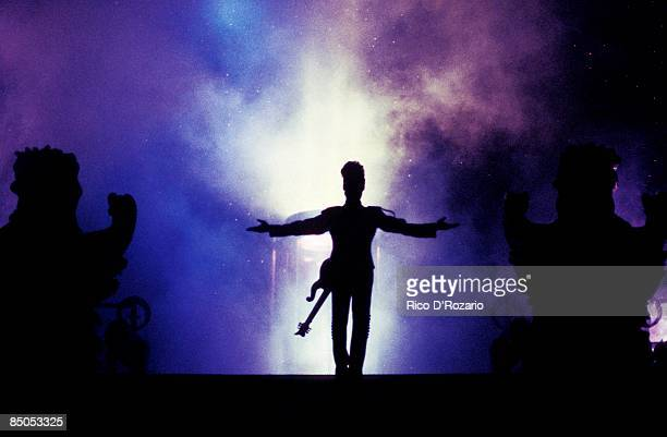 Photo of PRINCE; Prince performing on stage, silhouette