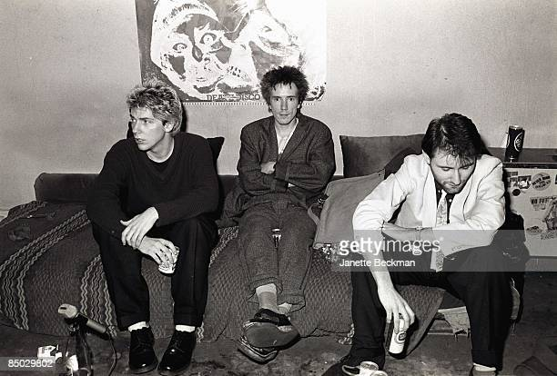 Photo of Public Image Ltd John Lydon with members of PiL photographed at his apartment in Notting Hill Jah Wobble on right