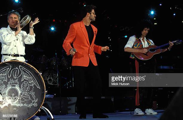 """Photo of QUEEN and Brian MAY and Roger TAYLOR and George MICHAEL; L-R: Roger Taylor, George Michael, Brian May performing live at the """"Freddie..."""