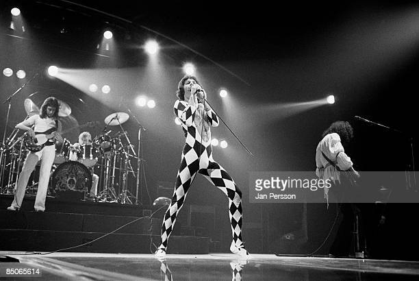 Photo of QUEEN and Freddie MERCURY and Brian MAY and John DEACON and Roger TAYLOR LR John Deacon Roger Taylor Freddie Mercury Brian May performing...