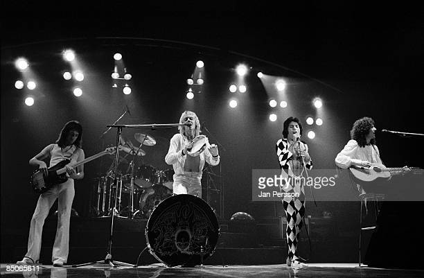 Photo of QUEEN and Freddie MERCURY and John DEACON and Roger TAYLOR and Brian MAY LR John Deacon Roger Taylor Freddie Mercury Brian May performing...