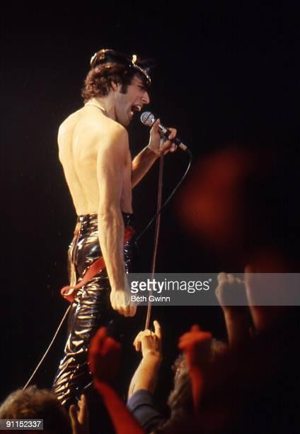 NASHVILLE Photo of QUEEN and Freddie MERCURY Freddie Mercury performing on stage audience hands